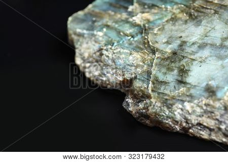 Beautiful Labradorite Gemstone On Black Background, Closeup