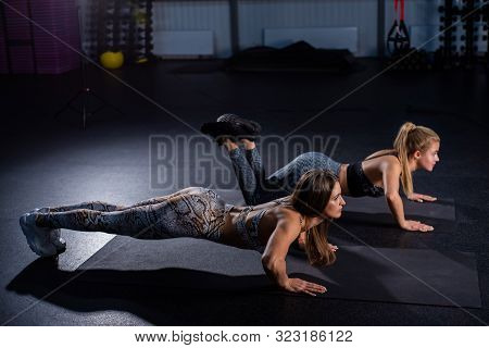 Female Trainer Teaches Ward To Do Push-ups Correctly. Beautiful Woman Trainer Makes Sure That Her Cl