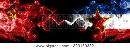 Communist Vs Yugoslavia Abstract Smoky Mystic Flags Placed Side By Side. Thick Colored Silky Smoke F