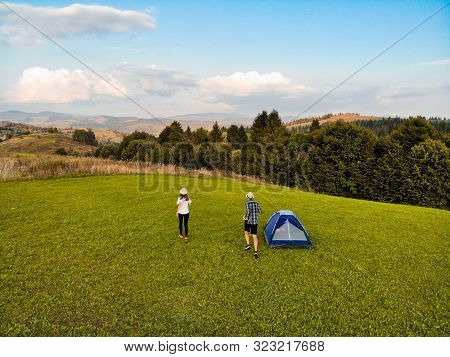 Aerial View Of Love Couple Of Hikers Spend Time Together Away From City Bustle By Sunrise In Camping