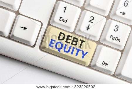 Text sign showing Debt Equity. Conceptual photo dividing companys total liabilities by its stockholders White pc keyboard with empty note paper above white background key copy space. poster