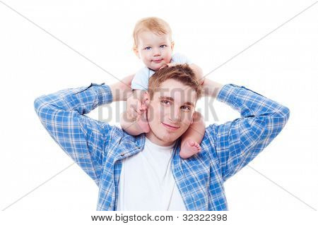 studio shot of little boy sitting on shoulders of his father. isolated on white