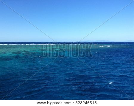 Coral Reef In The Great Barrier Reef, Visible By Coloration Of The Water, Reefs Are Often Bleached