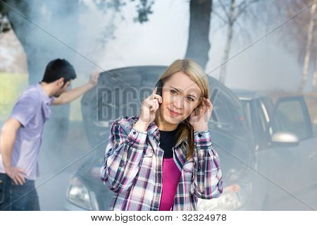 Car breakdown woman call for help road assistance smoking engine