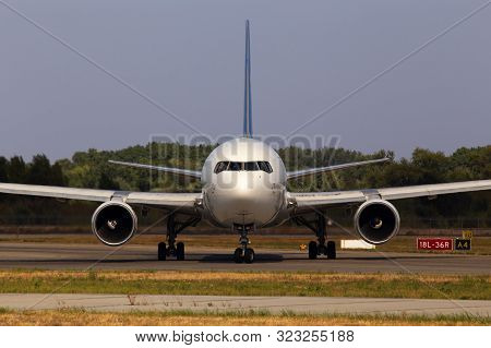 Big Modern White Aircraft Running To The Parking Area, Front View