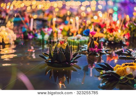 Loy Krathong Festival, People Buy Flowers And Candle To Light And Float On Water To Celebrate The Lo