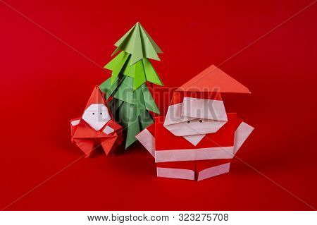 New Year Card Handmade Origami Santa Claus On A Sleigh With Trees. Christmas Concept Winter Crafted