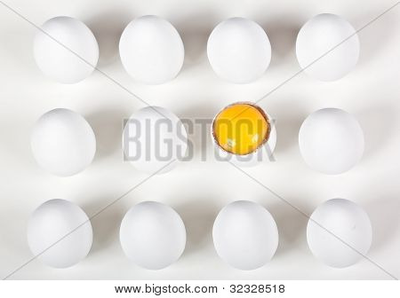 One Broke Egg Amongst Whole White Eggs