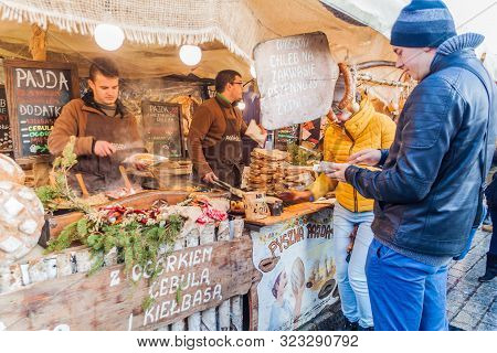 Krakow, Poland - December 2, 2017: Traditional Food Stall At The Christmas Market At Rynek Glowny Sq