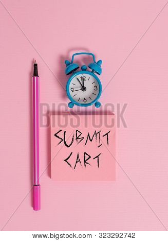 Text sign showing Submit Cart. Conceptual photo Sending shopping list of online items Proceed checkout Metal vintage alarm clock wakeup blank notepad marker colored background. poster