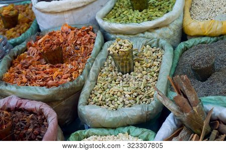 Various Colorful Essential Indian Himalayas Traditional Spices, Herbs And Seasonings In Burlap Sack
