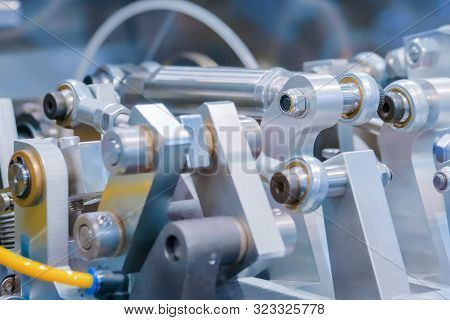 Close Up View - Moving Parts Of Hydraulic Industrial Automotive Machine Tool Equipment. Abstract Ind