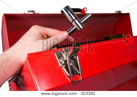 Hand Removing A Wrench From A Toolbox
