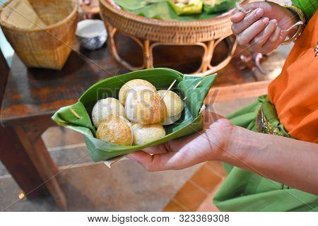 Kanchanaburi, Thailand, 09.09.2019: Thai Coconut-rice Pancakes Served In Folded Banana Leaves In The