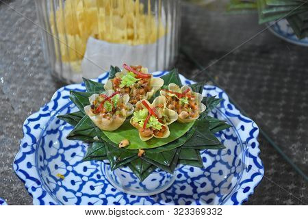 Delicious Thai Desserts Served Elegantly On Folded Banana Leaves And On Beautiful Porcelain Bowl