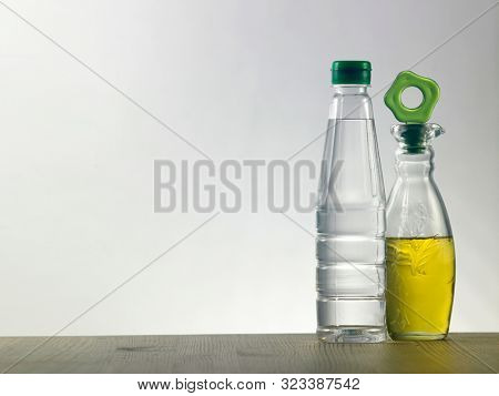 Oil and vinegar on the white background