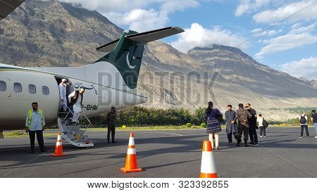 Passengers Coming Out Of Plane At The Runway After Landing, At Beautiful Airport Of Gilgit Baltistan