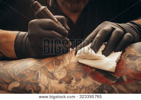 Close Up Of The Tattoo Machine. Tattooing.