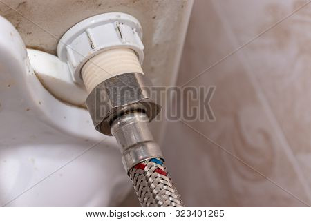 Water Supply Fitting Of Cistern Tank Of The Toilet Bowl At Water Closet Close Up