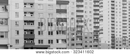 gray sad black and white view to city multiple-dwelling apartments with balcony frontview poster