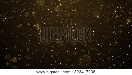 Golden glitter with bokeh light, gold particles splash on luxury black and gold background. Golden sparks splash, shimmer glow flow