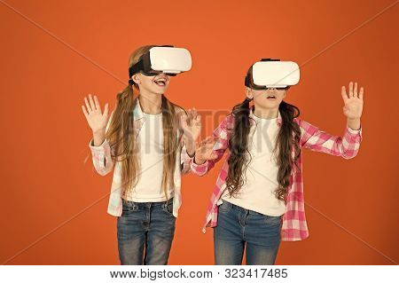 Kids Girls Play Virtual Reality Game. Friends Interact In Vr. Explore Alternative Reality. Future Is