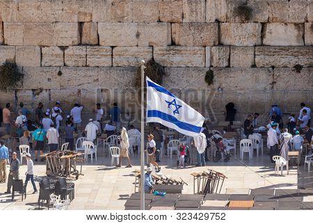 Jerusalem, Israel, September 07, 2019 : Israeli Flag Flies In Front Of The Kotel In The Old City In