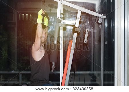 Strong Muscular Asian Man Lifting Weights Exercise His Breast In Fitness Gymnasium,sport And Healthy