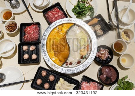 Chinese Steamboat With Two Soup Variety Accompanied With Various Ingredients