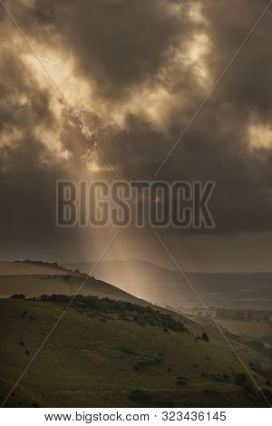 Beautiful Summer Landscape Image Of Escarpment With Dramatic Storm Clouds And Sun Beams Streaming Do