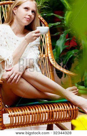 Girl With Cup Of Tea In Garden