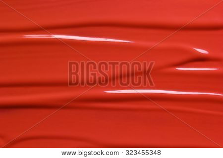 Red Lipstick Texture Background. Beauty Cosmetic Product Or Paint Sample. Liquid Lipstick Or Lip Glo