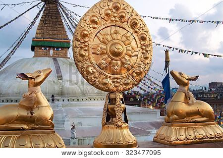 Boudhanath Stupa From Nearby Buddhist Temple With Two Deer And Wheel Of Life On Foreground In Kathma