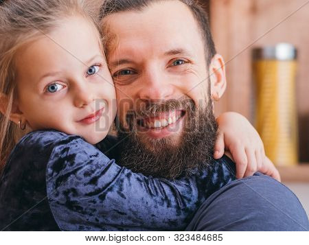 Happy Family Relationship. Closeup Portrait Of Cute Little Girl Hugging Her Dear Father With Love An