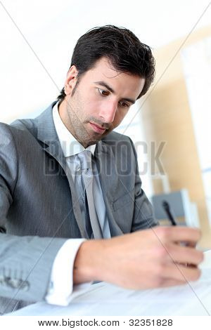 Businessman filling in business contract