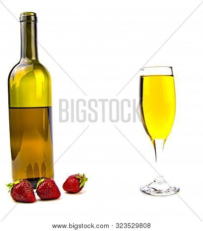 Glass Of White Wine With A Bottle And Strawberries On A White Background. Place For Text.