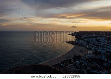 Aerial Drone View Of People Resting Porto De Mos Beach In Lagos, Algarve, Portugal
