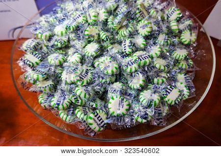 Seattle, Wa/usa-9/16/19: A Closeup View Of Wrapped Starlight Mint Hard Candies In A Clear Glass Or P