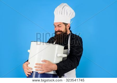 Handsome Male Chef With Saucepan. Chef Man In Hat Holds Pan. Man In Chef Uniform With Saucepan. Bear