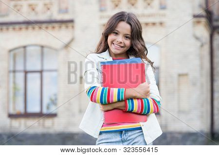 How About A Date With A Genius Book. Happy Schoolgirl Or Wonder Kid Holding Books With Genius Ideas