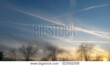 Contrails At Sunset In A Winter Sky