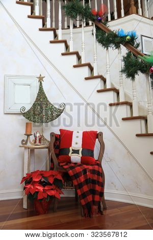 A warm, welcoming entry way greets guests in this home decorated for the Christmas holiday.