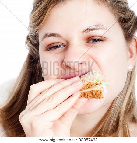 Woman Enjoying Eating Sandwich