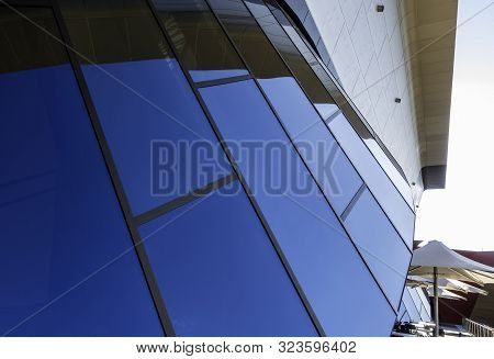 Canberra, Australia - Apr 23, 2018: Blue Glass Window Panes Arranged In An Arch As A Contemporary Ar
