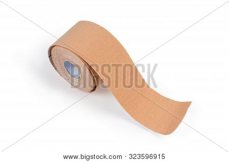 Roll of the flesh-colored elastic therapeutic tape, also known as kinesiology tape on a light background poster