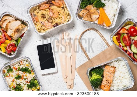 Food Delivery. Different Aluminium Containers With Healthy Natural Food On White Office Table. Top V