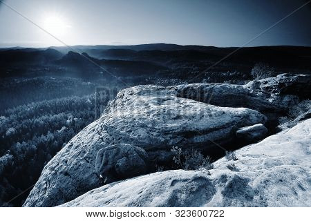 Blue Spring Daybreak, Thawing Of Last Snow. Sandstone Cliff Above Deep Misty Valley.