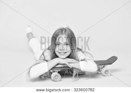 Trendy Girl. Kid Adorable Child Long Hair Adore Ride Penny Board. Ride Penny Board And Do Tricks. Gi