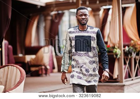 Handsome Afro American Man Wearing Traditional Clothes In Modern City.