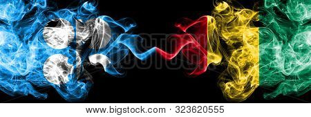 Opec Vs Guinea, Guinean Abstract Smoky Mystic Flags Placed Side By Side. Thick Colored Silky Smoke F